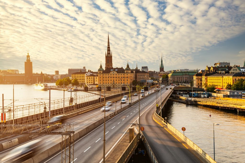 Scenic view of old buildings and car traffic at the bridge Stockholm, Sweden